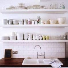 butcher block countertop, subway tile, open shelves