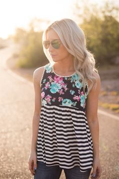 We don't believe a tank can get any cuter than our Floral + Stripes Tank!