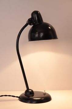 This is the KAISER IDELL 6551 model which was designed by Christian Dell part of the Bauhaus movement in the 1930-40's. The lamp is fully