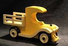 Old fashion stake side bed pickup, Just made to hall , this is a 71/2inch long, 5inch high and 3inch wide truck It comes in natural with clear sealer, Colors are (bodfy\ fenders and bed ) yellow/light yellow and blue/white, orange/black, red/white, pink/burgundy . It is an amazing little
