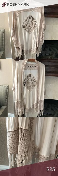 Beautiful Crochet Cardigan! Fringe detail atbottom This gorgeous cardigan is going to go fast! Crochet detail on back and trim. Fringe detail on bottom. Only worn 1 X. S/M, can fit M/L too. Umgee Sweaters Cardigans