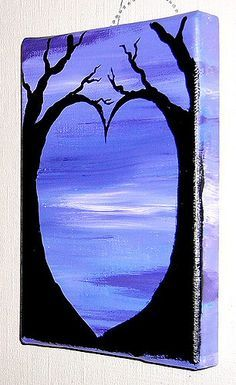 """Inspired by trees silhouetted against the sunset, this piece has two trees in black acrylic standing out against a purple sky in acrylic paint. These trees curve and join together to form a heart in the space between. The colours of the purple sky continue over the sides of the canvas on which this is painted, to give one continuous block of colour. This canvas measures 12cm (7"""") high by 18cm (5"""") wide."""