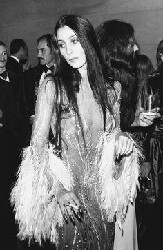 Cher attending the 1974 Met Gala in Bob Mackie