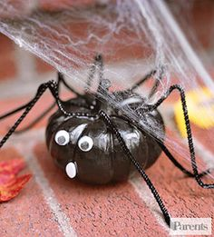 Make pumpkin spiders from mini pumpkins