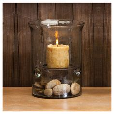 Found it at Wayfair - Glass Cylinder Hurricane Lantern. I want to do this accept wth my orang beach sand and shells.