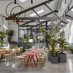 A former auto repair garage has been transformed by Mim Design into a contemporary hospitality space in the guise of a sprawling indoor botanical garden. Hotel Interiors, Office Interiors, Mim Design, Garage Repair, News Cafe, Garden Cafe, Bar Interior, Cafe Bar, Indoor Garden
