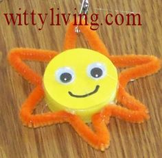 sun swap made from a bottle cap, pipe cleaner, and googly eyes