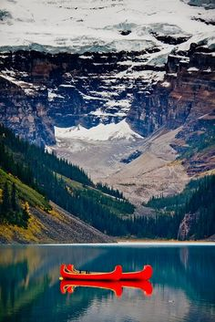 Lake Louise, Canada....love the bright contrast of the canoes in this shot