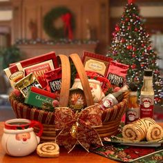 Barista Holiday Coffee Gift Basket / This makes a great corporate gift or for that beloved gourmet coffee lover.  With an array of gourmet flavored coffees, cream filled cake and more, you certainly will make a coffee fanatic very happy. http://ruthannsgiftbaskets.com/barista-holiday-coffee-gift-basket $84,40