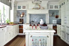 Saw this kitchen in a magazine years ago, and it's still so relevant! One of my absolute favs from the marble island and butcher block counters to the hidden fridge and blue subway tiles