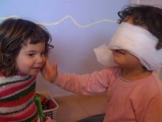 our circle time, easy activity to do , is aimed at building self esteem and a positive self image. Here you can see Tevel is blindfolded and feeling Hila's face, with the aim at guessing who is sitting in front of him. When doing this, they are encouraged to speak about what they are feeling, for example 'pretty, curly hair', 'happy smile'. When they guess it causes great excitement for everyone.