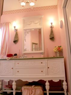 Shabby Chic Pink    A gorgeous white buffet is the focus of this shabby chic master bathroom by RMS user MyLittleYellowHouse. The pink walls and frills are a soft contrast against the white buffet and mirror and make this space perfect for any girly girl.    HGTV Idea