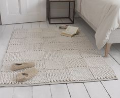 Our Guernsey floor rug is a simple chunky knit, just our style. It comes in medium and large sizes and is completely handmade. Thumbs up all round!