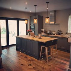 Howdens Fairford in Graphite with solid oak worktops & neff appliances. Howdens Fairford in Graphite with solid oak worktops & neff appliances. Walls Farrow & Ball Purbeck Stone with ceiling in blackened.