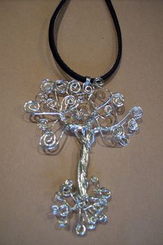 This Tree of Life is made entirely of Sterling Silver. I am happy to add stones if you desire. Pictured without stones it is $55.