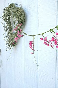 Wreath: Heart shaped wreath: decorated with southern moss and a few small pink and red flowers randomly glued around wreath. Add a cute small song bird(s), owl, and a red/pink hand sewn stuffed heart on a real twig that is  hot glued to go across the wreath.