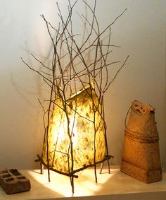 """Luminary with Red Bud branches 