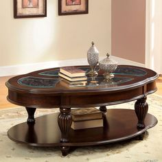 Add an air of sophistication to your living room with this elegantly crafted and expansive Zerathe Coffee Table. Glass inserts, wood carvings and regal reeded legs make this coffee table the perfect piece for creating a traditional setting.