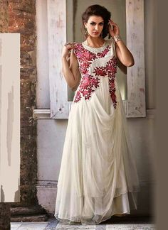 Latest off white net and georgette gown, with embroidery, resham, zari, bead, lace and patch border work. Available with matching santoon inner. (Slight variation in color is possible.)...