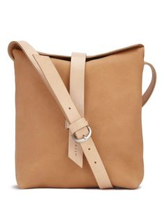 Crafted in a family-run factory in Portugal, this soft leather shoulder bag is the perfect addition to any casual look. It features a strong bridle leather adjustable strap and a supple leather that will age beautifully over time. A signature feature of t