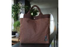 Coffee-dyed bags by Porter for Sarutahiko Coffee