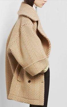 """by Chloé November 14, 2012. One meeting after another, running around town. Reminiscent of the 60s and 70s, Chloé's PF2012 look consisted of flowy proportions, oversized coats, and pleats. Clare Waight Keller,  Chloé's creative director, calls her second collection """"a mishmash."""" http://blogdivine.com/2016/07/18/oversize/"""