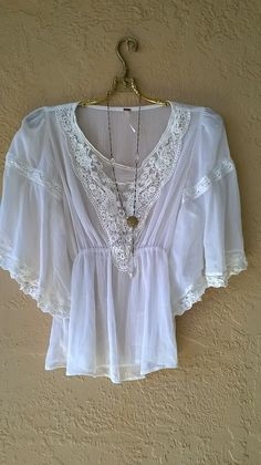 Image of Free People rare White with crochet and lace Peasant blouse from past season in mint condition