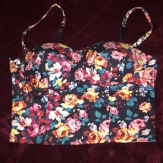 Charlotte Russe floral bralette/ crop top This is corset style , floral bralette/ cropped top from Charlotte Russe.. Really adorable, with zipper in back.. Straps are adjustable.. Fits equivalent to a 34A or B.. Great condition Charlotte Russe Tops Crop Tops