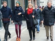 December 22, 2014 They've made this city their own! Taylor Swift hits the streets of N.Y.C. on Monday with her crew, including brother Austin, mom Andrea and dad Scott.