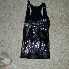Sequin tank This is a fitted tank. Long. No missing sequins Tops