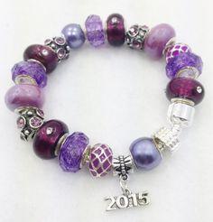 A personal favorite from my Etsy shop https://www.etsy.com/listing/229310310/graduation-2015-charm-bracelet