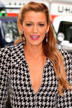 Blake Lively sideswept waves - click through to see more of her press tour hairstyles + details!