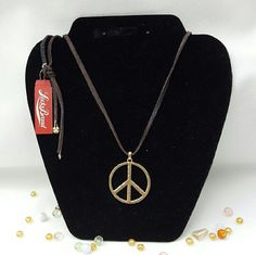 "Hammered Brass Peace Leather Necklace Lucky Brand. Semi Precious Accents line.  24"" full length leather necklace. Adjustable with tie closure. Brass peace sign symbol pendant measures 1.5"". Brand new with tags. Add a touch of boho chic to any outfit. Lucky Brand Jewelry Necklaces"