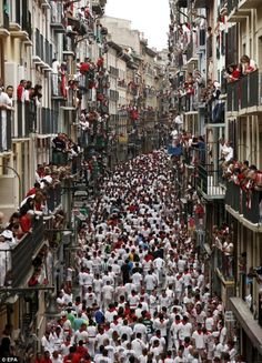 I'm not condoning the running of the bulls - but this photo is amazing!  Estafeta Street in Pamplona crowded with runners before the first bull run started