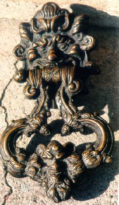 Google Image Result for http://images.oneofakindantiques.com/5465_bronze_door_knocker_1.jpg