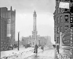 A 1926 photograph of The Water Tower (one of the few buildings that survived the Great Chicago Fire of 1871). Chicago, Illinois. Photograph by Chicago Daily News, Inc.