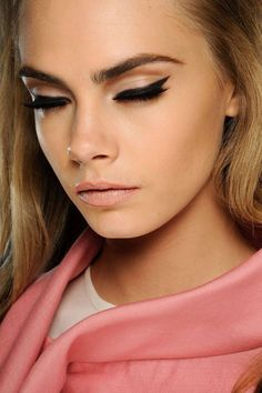 pin-up cat eyes on the doll-faced Cara Delevingne