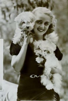 Bette Davis with her twin French Poodles (1932)