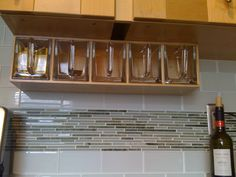 Better photo of the under-cabinet storage for flour etc. click on picture to go to web page and read all about it - Linda