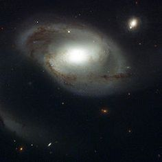 A Hubble Space Telescope (HST) image of NGC 4319. Quasar Markarian 205 is visible to the upper right.