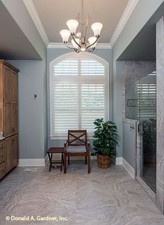 Elegant master bathroom of The Chesnee. House design #1290.