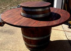 all of our wine barrel tables come with a cover for the center fire pit when the… Whiskey Barrel Table, Barrel Bar, Whiskey Barrels, Wine Barrel Crafts, Round Patio Table, Barrel Projects, Wine Barrel Furniture, Custom Tables, Lazy Susan