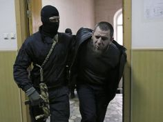 """Scapegoat or suspect? """"Tamerlan Eskerkhanov, [one of three Chechens] detained over the killing of Boris Nemtsov, is escorted inside a court building in Moscow, [today] March 8, 2015. REUTERS/Maxim Shemetov"""""""