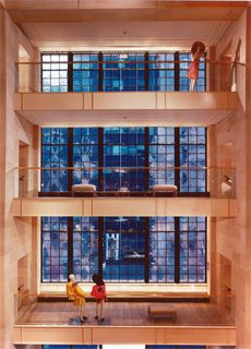 Henri Bendel, three stories of original Rene Lalique glass windows that depict intertwining vines.