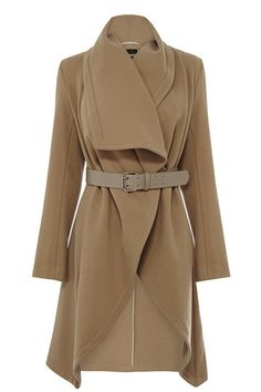 Our classic drape coat features a waterfall front with a wide wasit belt to create a cinched in, ladylike silhouette. The piece features long sleeve styling and a double pocket feature on the front.