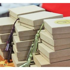 Putting tassels and labels on our Tizirii argan soap boxes.  a simple beautiful Moroccan inspired design  #tiziriibrand
