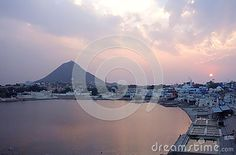 Photo about This is an aerial shot of Pushkar lake Rajasthan India during a dramatic sunset. Image of ganga, pilgrims, morning - 70733513 Rajasthan India, Opera House, Shots, Stock Photos, Celestial, Sunset, Building, Travel, Outdoor