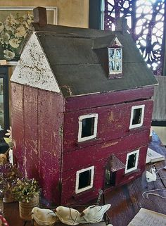 We had an old doll house, that looked a lot like this one, except that the front had been removed. We made most of the furniture our selves. That was probably the best part of it.