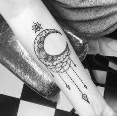 Ornamental mandala moon tattoo by Clara Welsh