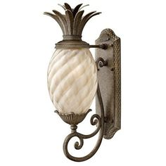 This pineapple exterior light fixture is very stylish.  Not too kitschy…actually quite contemporary.  It would set the tone for a beach house or a West Indies style plantation home or just to incorporate something a little out of the ordinary to your exterior decor.  A-Z Home Decor Trend 2014: Pineapples - Alice T. Chan, San Francisco Bay Area Interior Renovation and Design Specialist